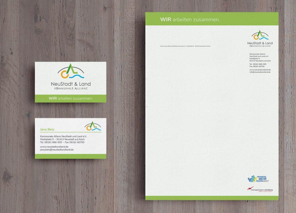 Logo der Kommunale Allianz auf einem Briefbogen und einer Visitenkarte
