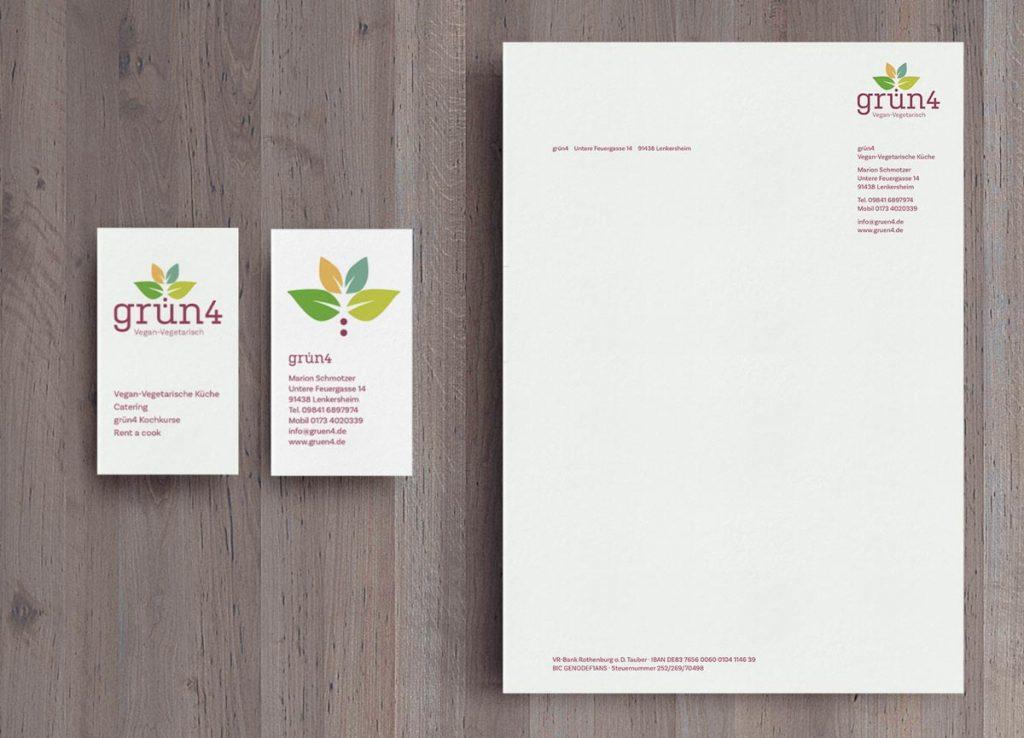 Logo von grün4 auf einem Briefbogen und einer Visitenkarte